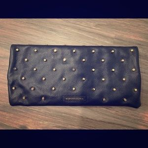 BCBG MaxAzria black leather clutch with gold studs